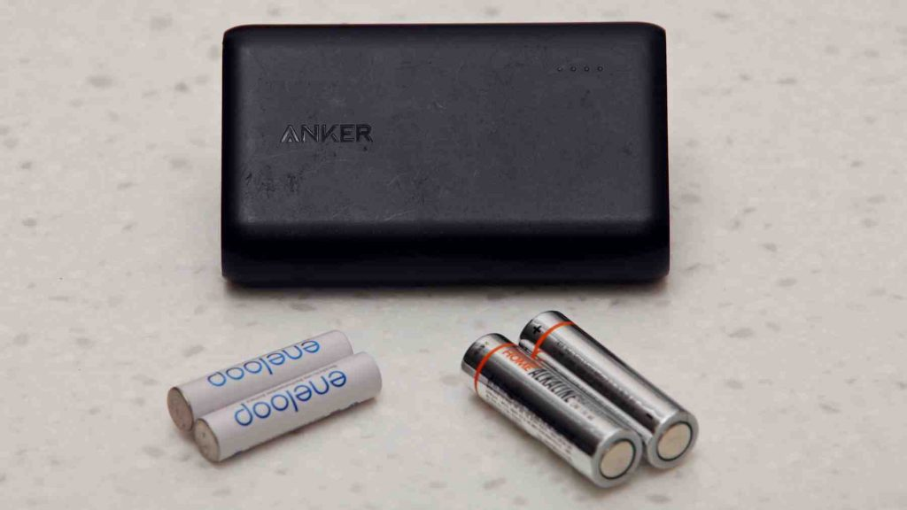 A picture of portable phone battery, AA, and AAA batteries.