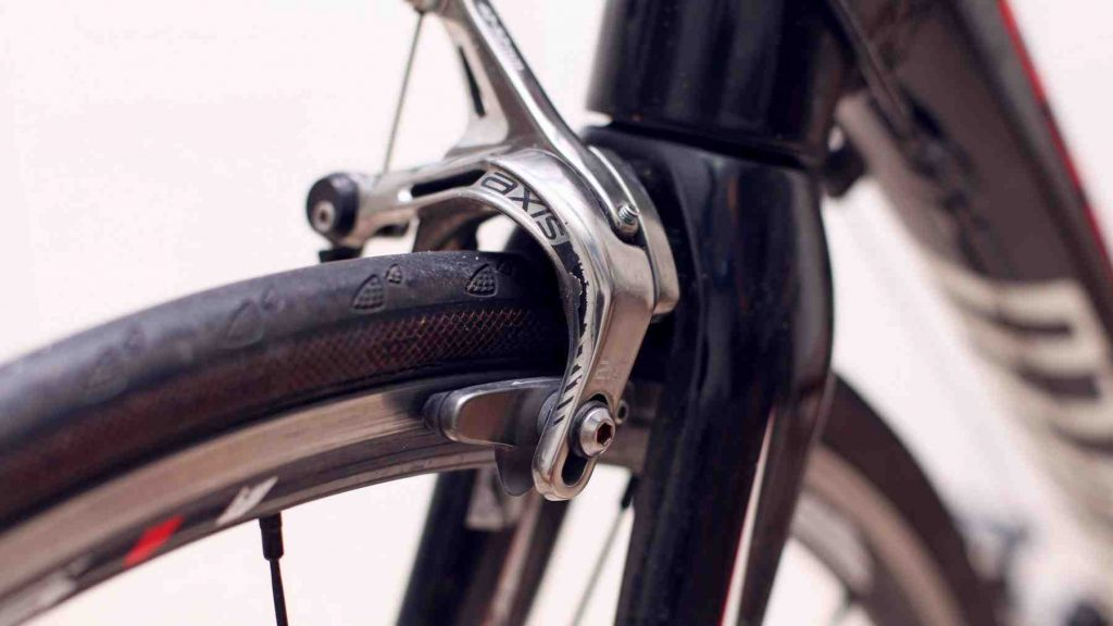 A picture of bike brakes and tire rim.