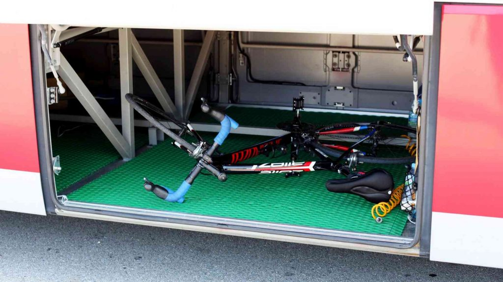 A picture of a bike in the luggage compartment of an intercity bus in Korea.