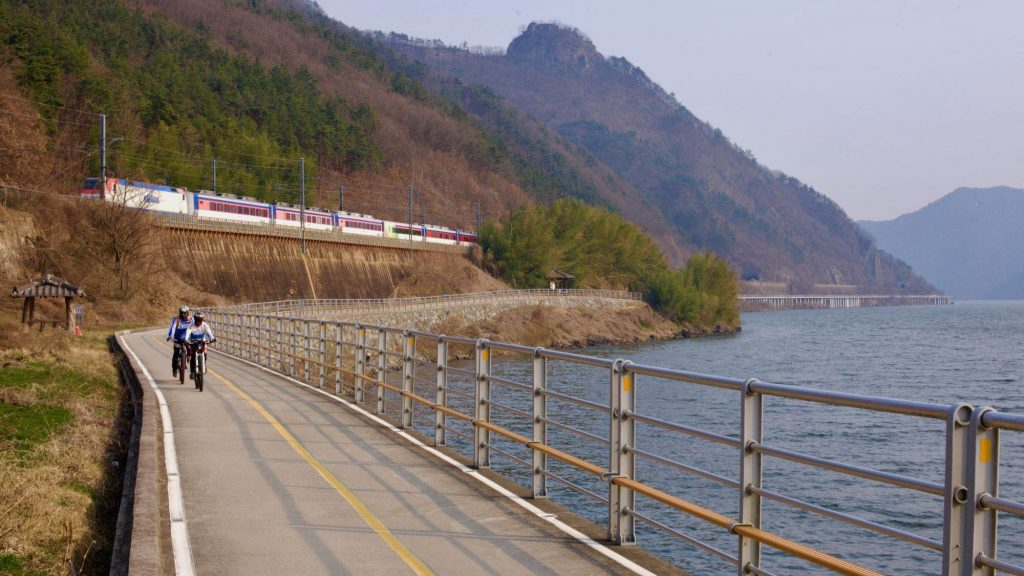 A picture of a train near the city of Yangsan in South Korea.